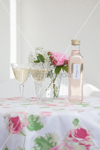 Two glasses of sparkling wine with homemade rose syrup