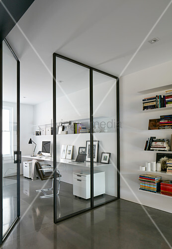 Glass and steel partition wall with door screening study