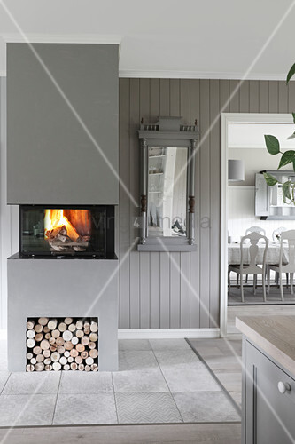Fire in modern fireplace in grey interior