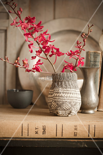 Vase with knitted cover
