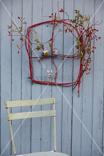 A DIY 'window' made from red dogwood twigs, rose hips and hawthorn berries