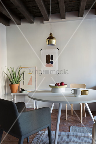 Scandinavian-style round dining table and accessories