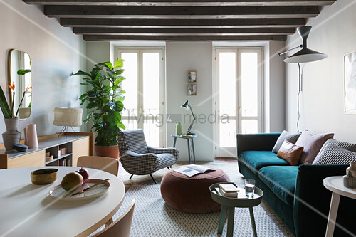 Interior with Italian designer-style dining table and sofa