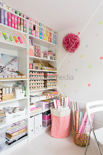 Neatly organised craft supplies on shelves in study