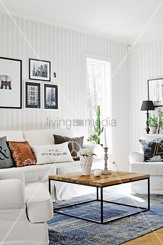 Coffee table with square metal frame in living room with striped wallpaper