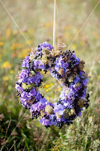 Wreath of purple hydrangeas and blackcurrants