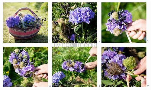 Tying a wreath of purple hydrangeas and blackcurrants