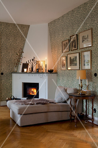 Chaise in front of fire in corner fireplace