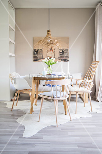 Round table, various chairs and sofa in dining area