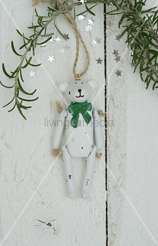 Christmas teddy bear and sprig of rosemary