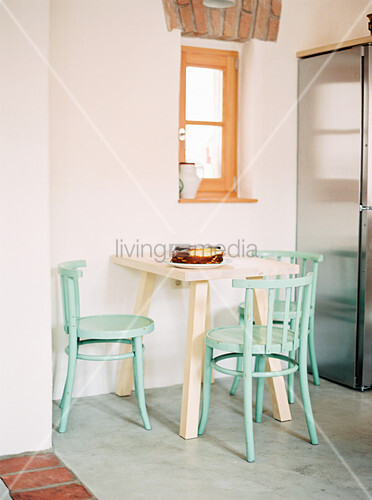 Small breakfast table with mint-green chairs