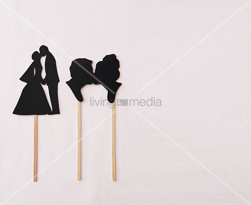 Bride and groom decorations hand-made from black card
