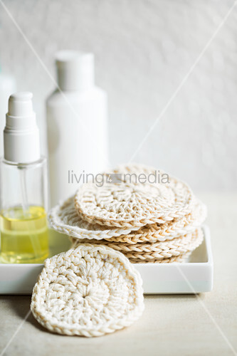Facial cleansing pads hand-crocheted from white cotton yarn