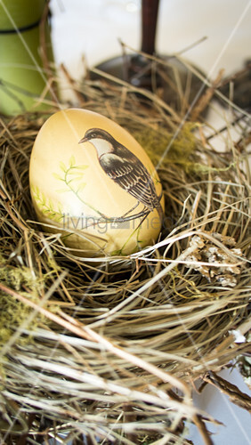 Painted egg in Easter nest