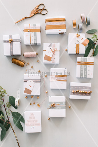 White boxes decorated with washi tape and string