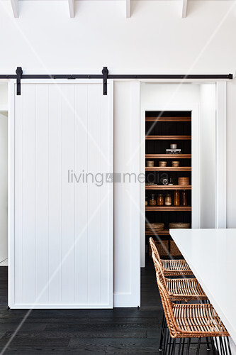 Pantry with white sliding door