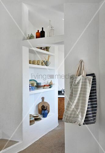 Crockery on masonry shelves