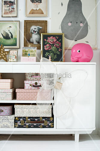 Boxes and suitcases in sideboard in child's bedroom