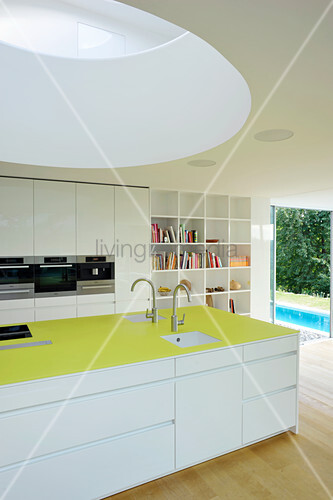 Modern kitchen with round skylight in architect-designed house