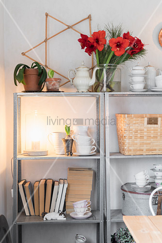 Crockery, books and Christmas decorations on open shelves
