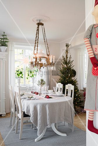 Set table in festively decorated dining room