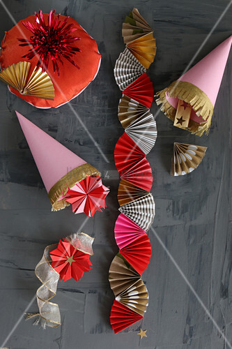 Christmas decorations hand-made from pink, red and gold paper