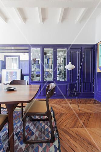 Vintage designer furniture in dining room of Parisian period building