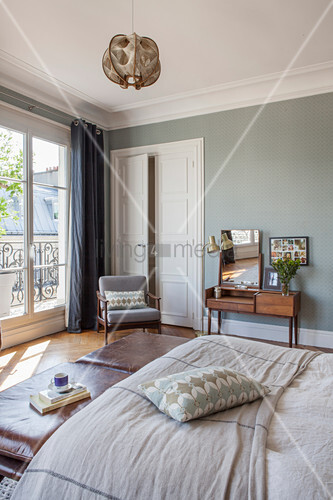 Vintage furniture in bedroom of Parisian period building