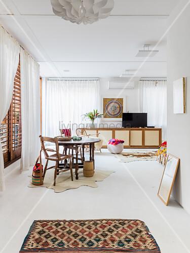 Ethnic-style artist's apartment with white floor