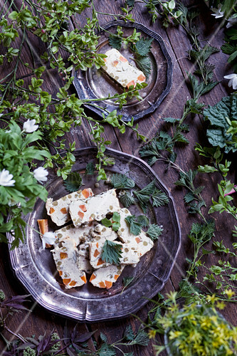 Fish and vegetable terrine scattered with herbs