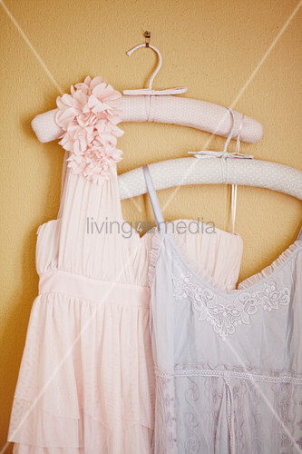 Vintage-style lady's clothing on clothes hangers