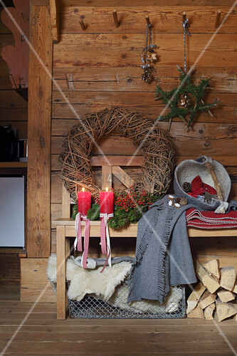 Christmas decorations and bench in rustic wooden cabin