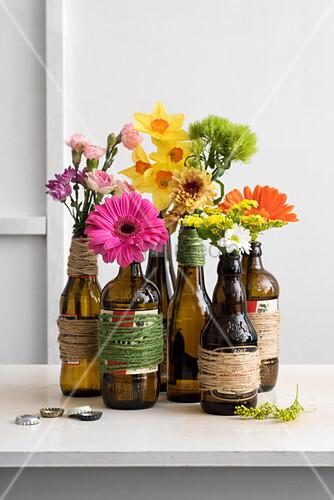 Flowers arranged in beer bottles