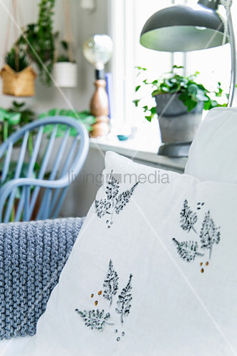 Cushion with printed leaf pattern and sequins