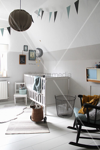 White Cot And Rocking Chair In Nursery Image