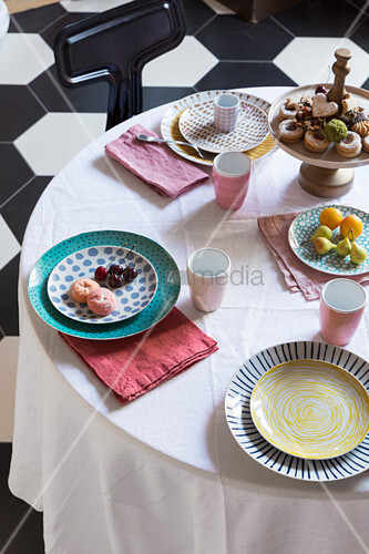 Table set with pastries and fruit