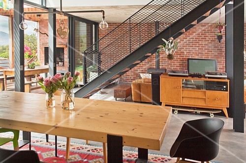 Steel girders and staircase in open-plan living area