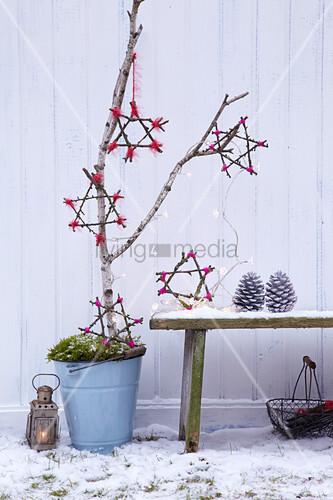 Handmade twig stars as festive garden decoration