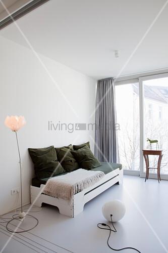 Stackable couch in minimalist bedroom