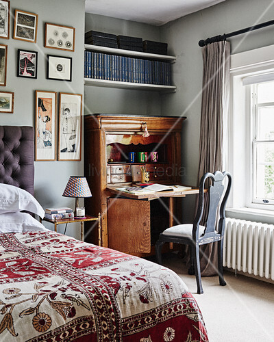 Antique bureau in traditional, English-style bedroom