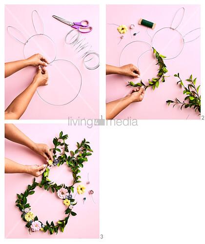 Kränze aus Blätterzweigen mit Papierblüten in Hasenform basteln