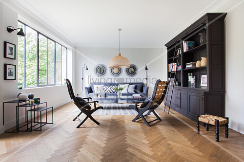 Dark bookcase, chairs, coffee table and … – Buy image ...