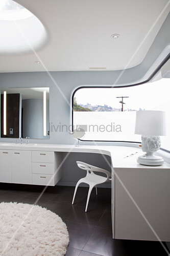 Curved walls in futuristic bathroom