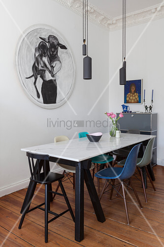 Dining table with marble top in sophisticated living room