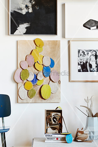DIY cardboard artwork above desk