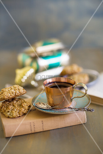 Cup of mocha coffee and biscuit on book