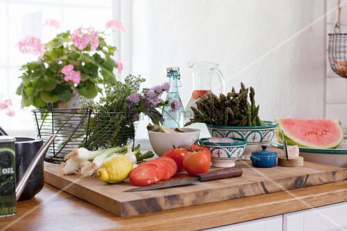 Fresh vegetables on chopping board in kitchen
