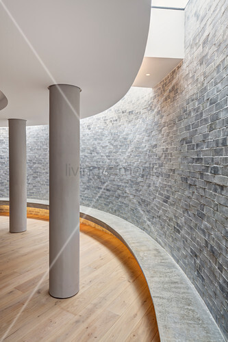 Detail of curved basement wall with lightwell