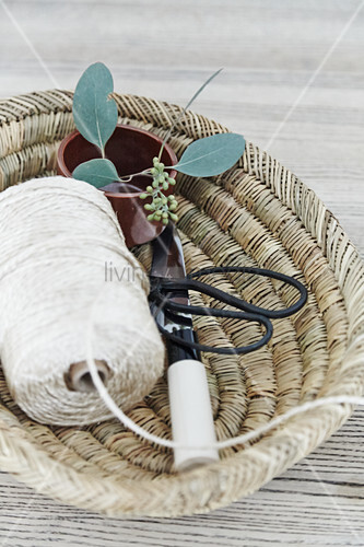 Decorative storage basket made from natural fibres