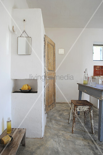 Dining table and bathroom area in rustic interior